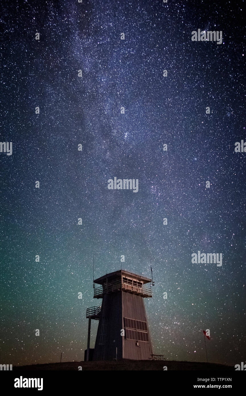 Tower against star field at night - Stock Image