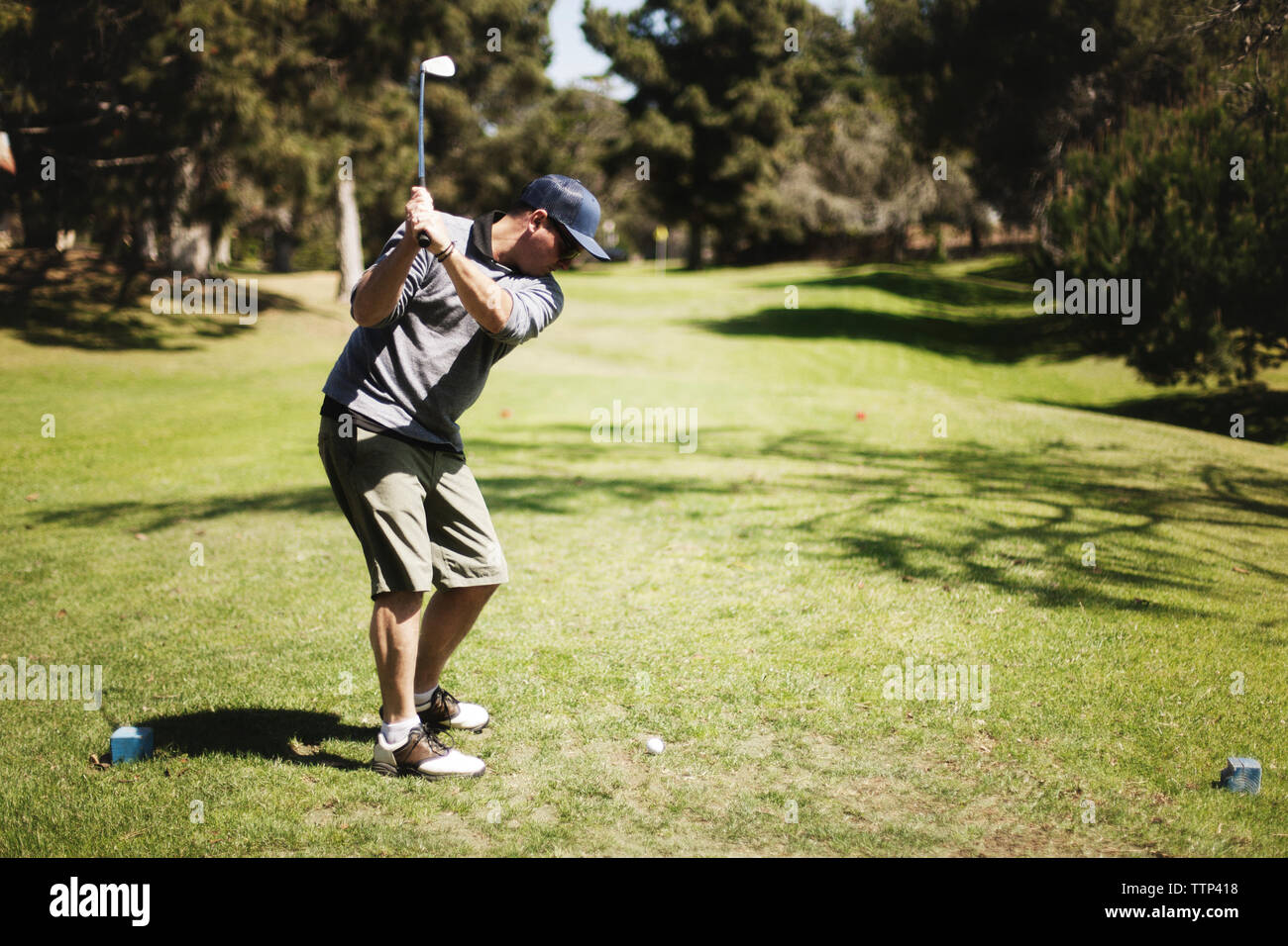 Golfer playing on field at golf club Stock Photo
