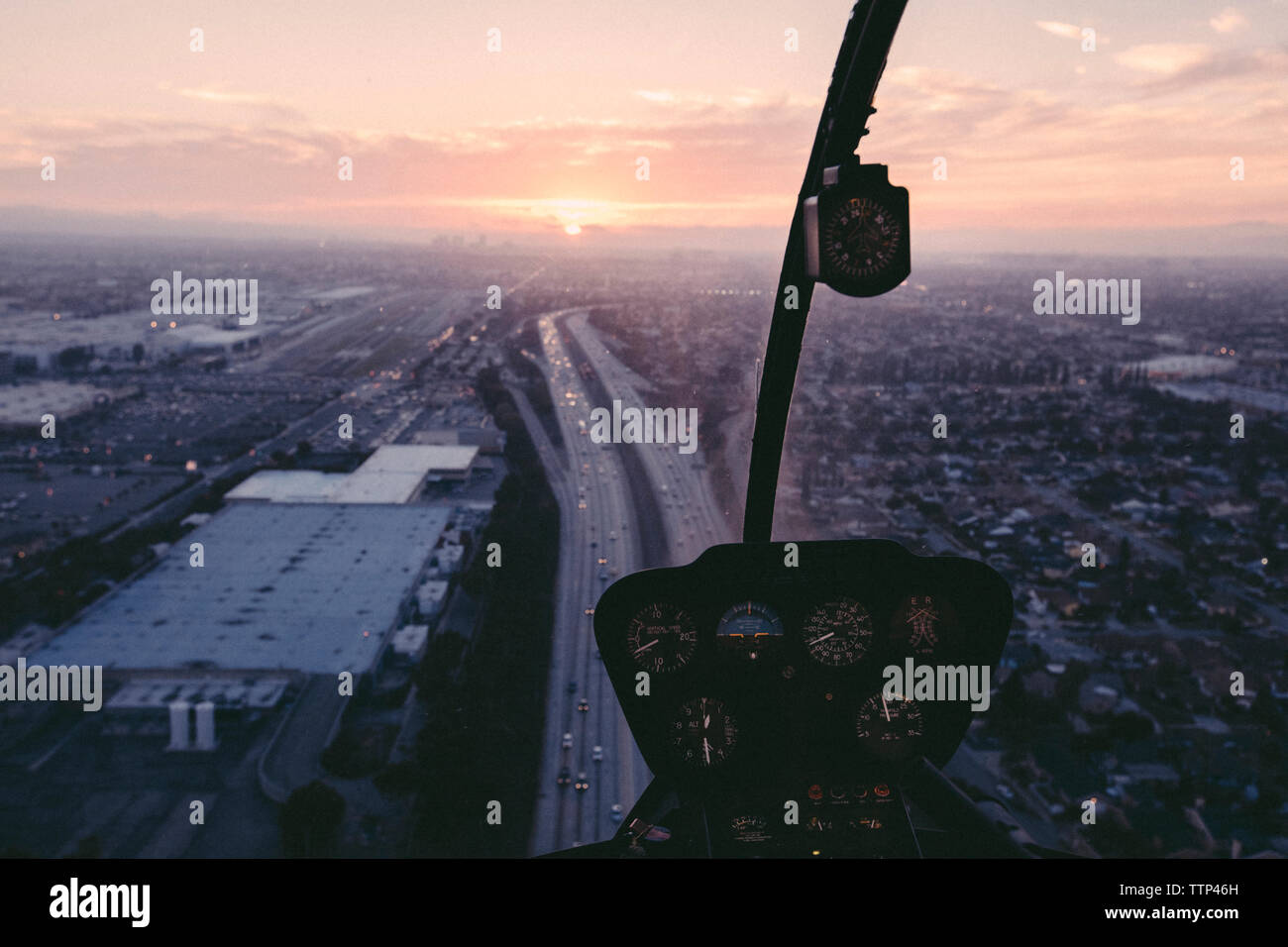 Cityscape seen from helicopter cockpit - Stock Image
