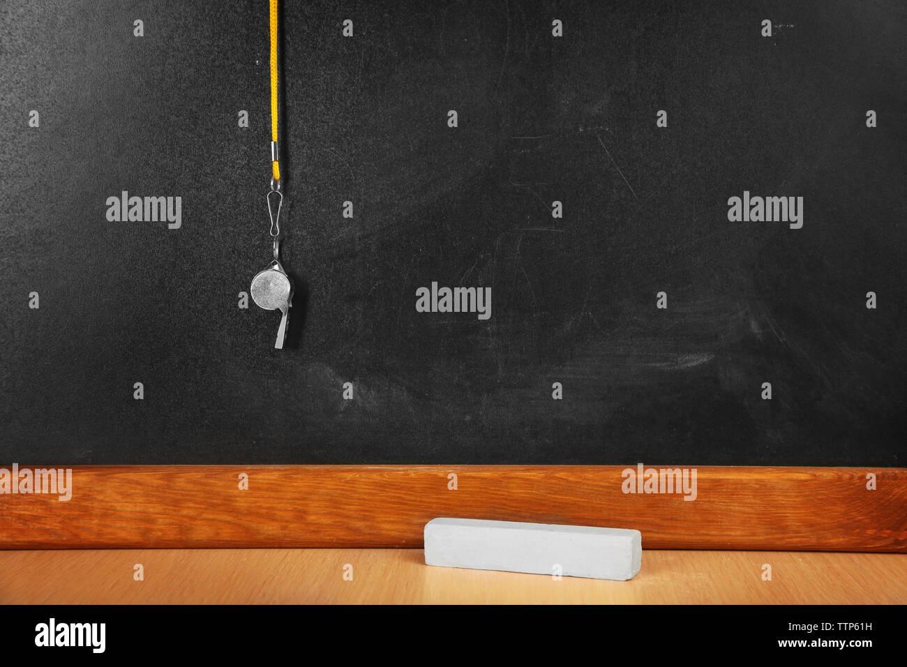 Whistle on blackboard background Stock Photo