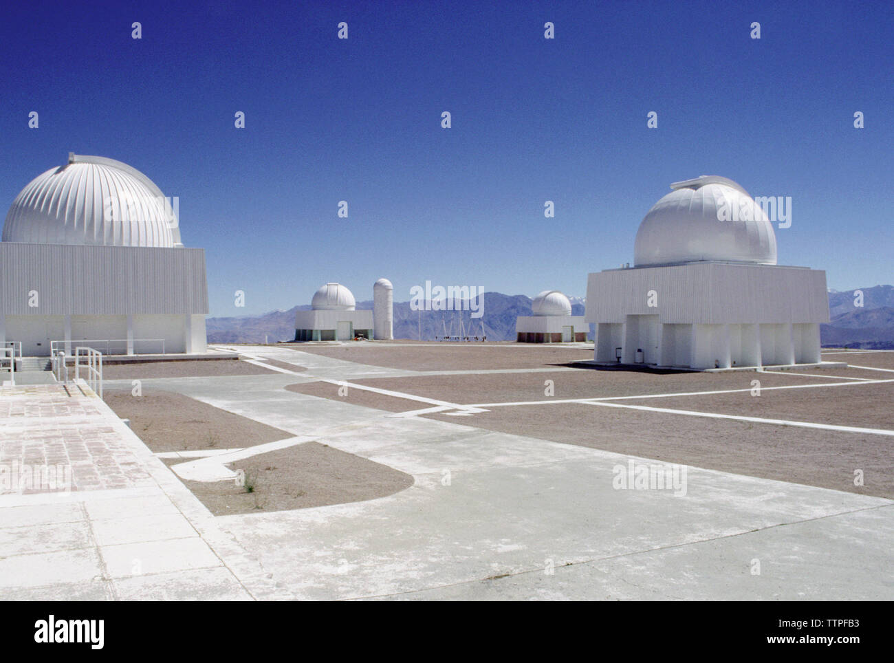 La Silla Observatory against clear blue sky Stock Photo