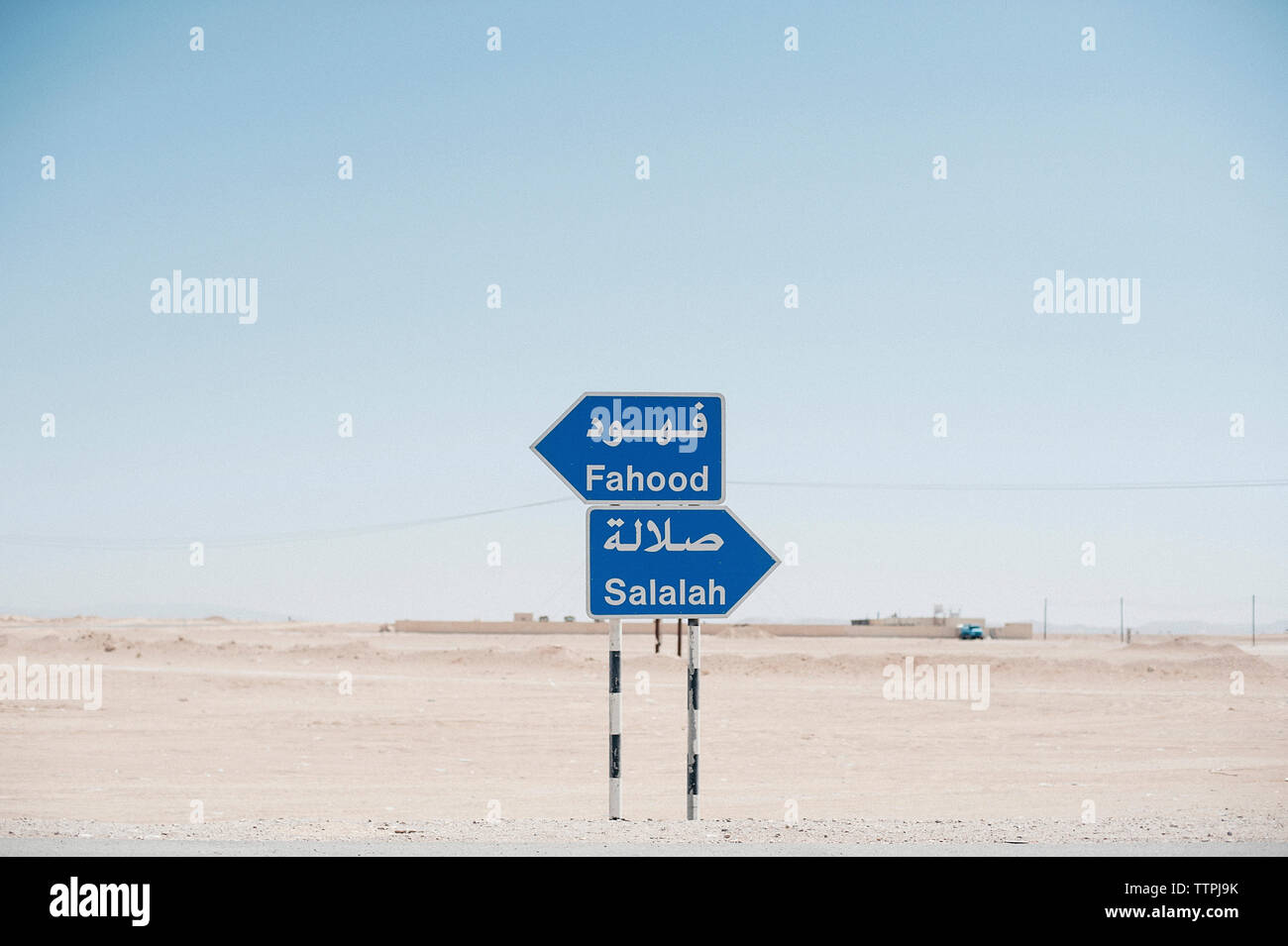 Signboards on desert against clear sky - Stock Image