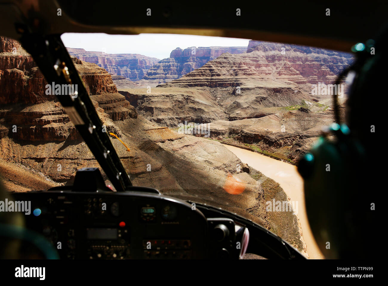 View of mountain ranges seen from helicopter cockpit - Stock Image