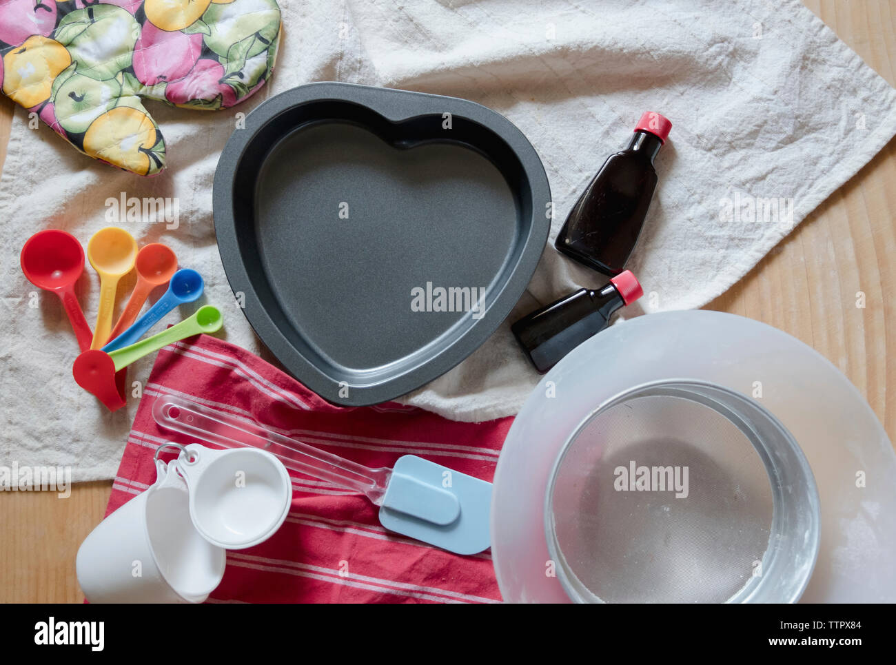 High angle view of various kitchen utensils on table - Stock Image