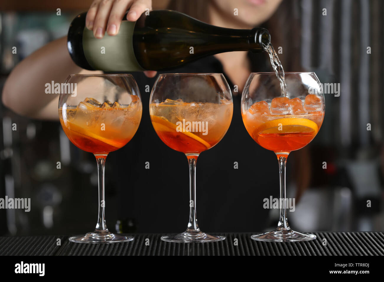 Woman hands making cocktail on bar counter Stock Photo