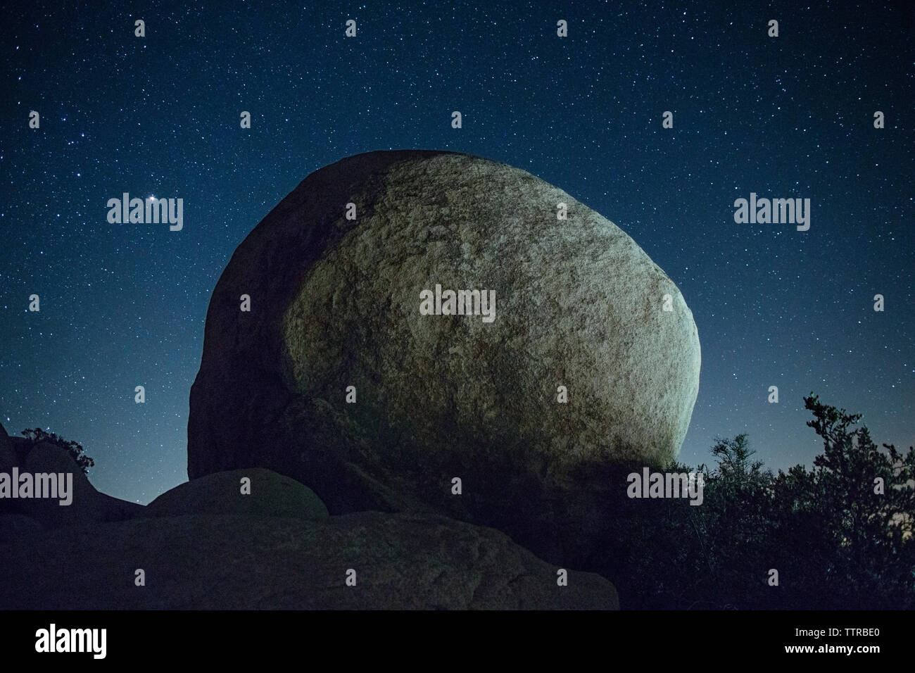 Rock against star field at night Stock Photo
