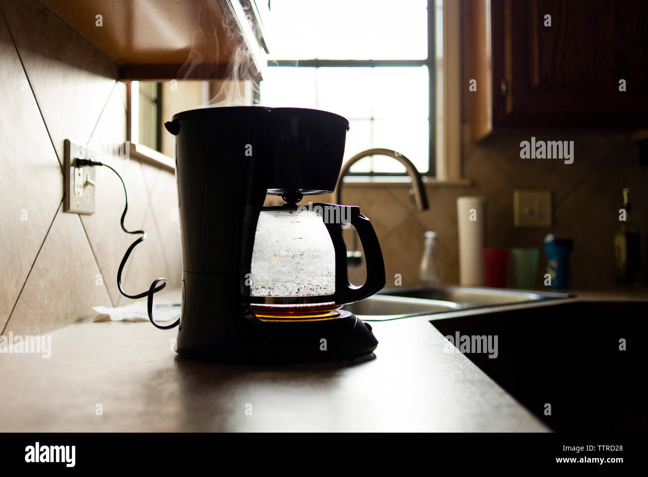 Coffee maker on kitchen counter - Stock Image