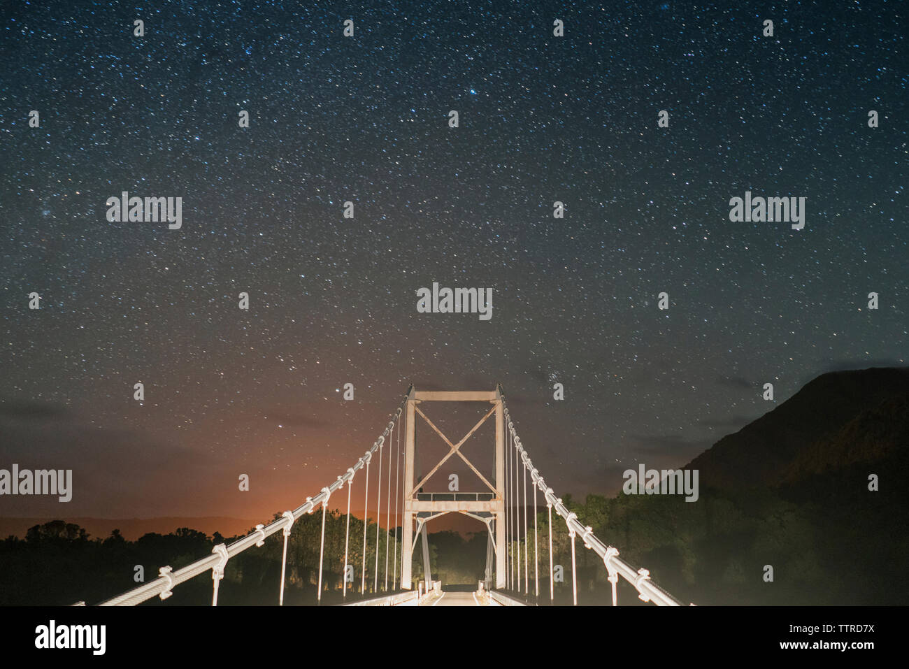 Bridge against star field at night - Stock Image