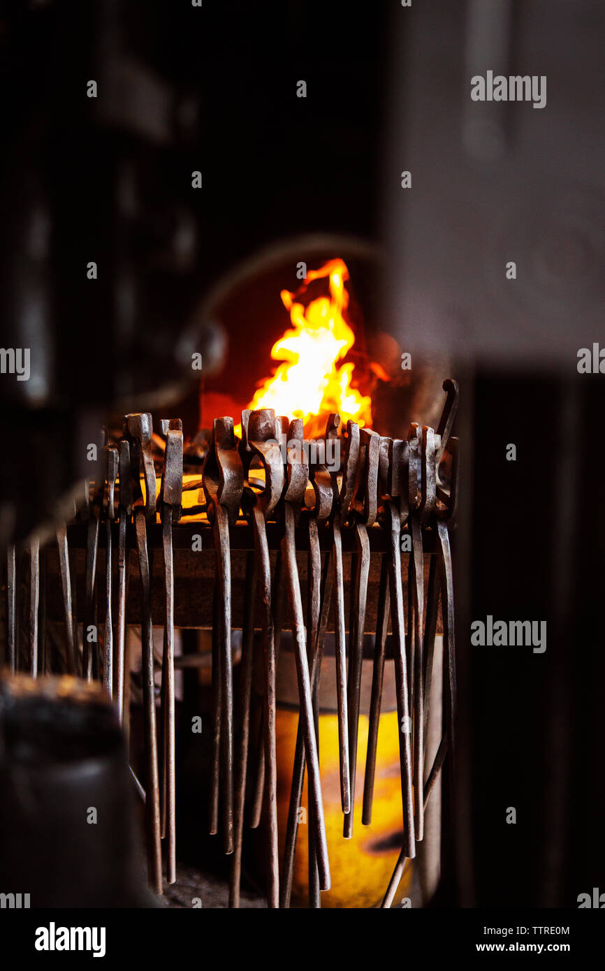 Various metallic tongs against fire in factory - Stock Image