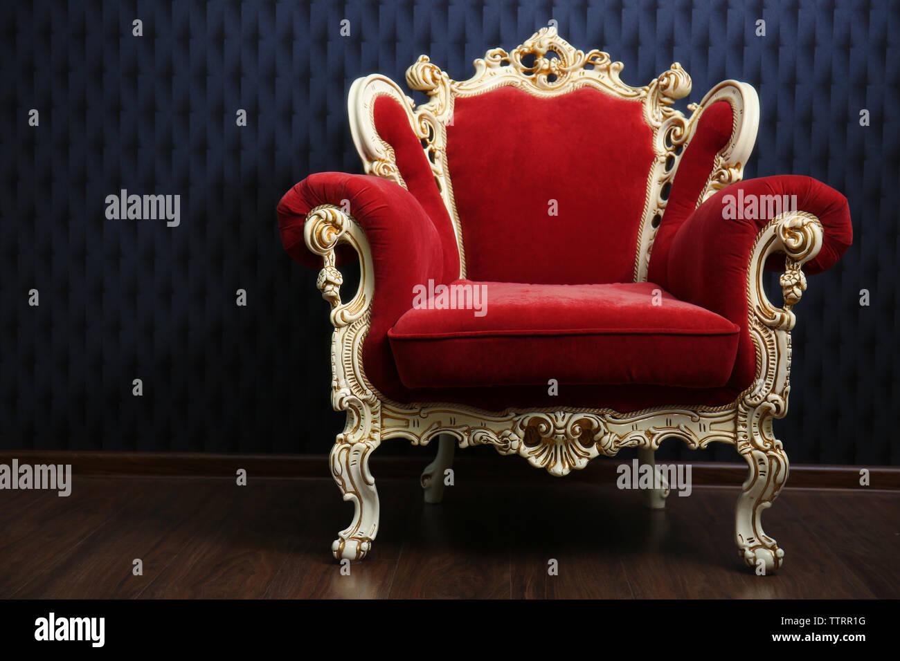 luxury red armchair on dark background TTRR1G