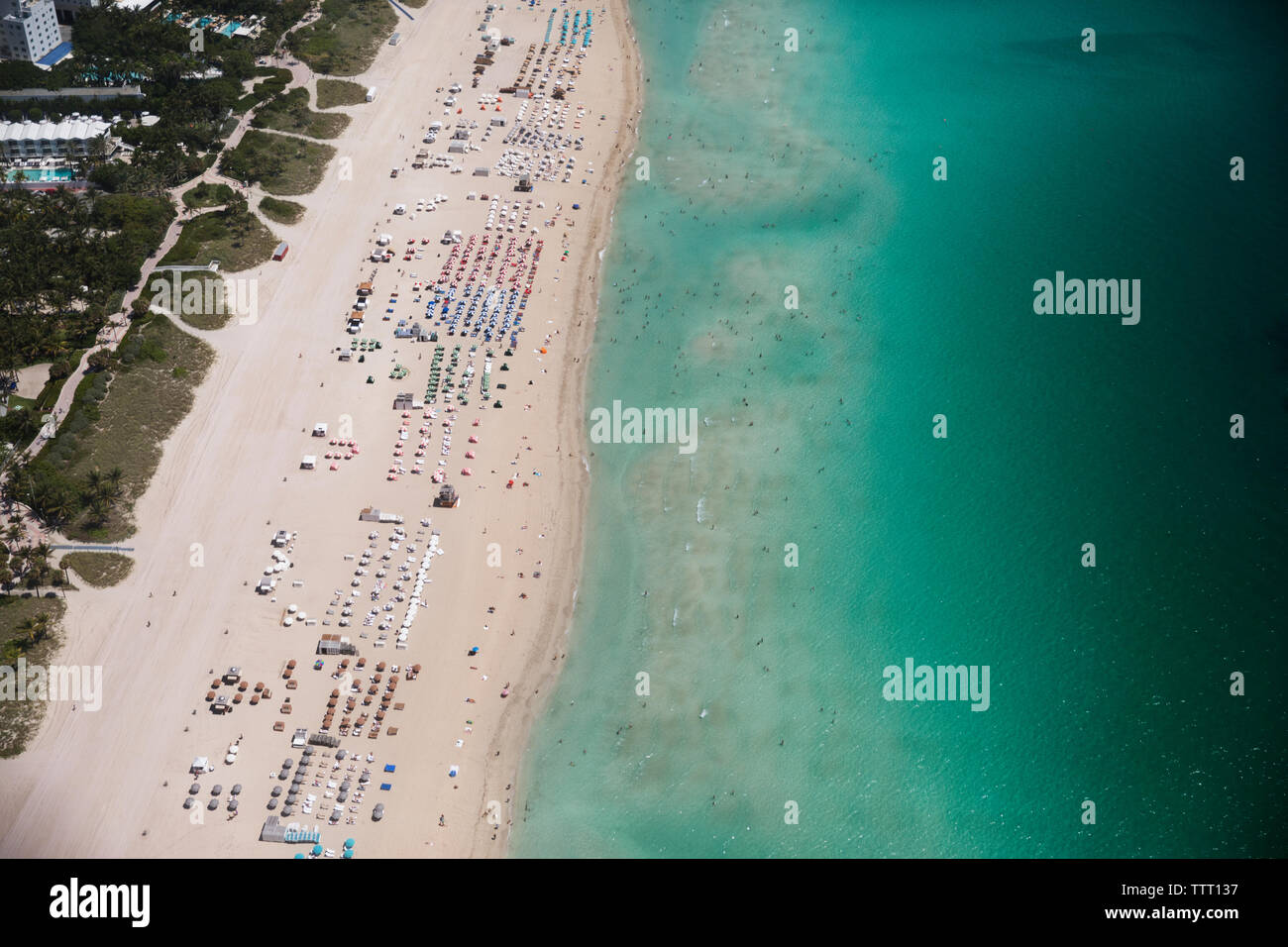 Aerial view of sunshades on beach - Stock Image