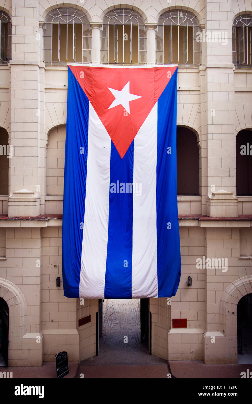Huge Cuban flag hanging from building - Stock Image