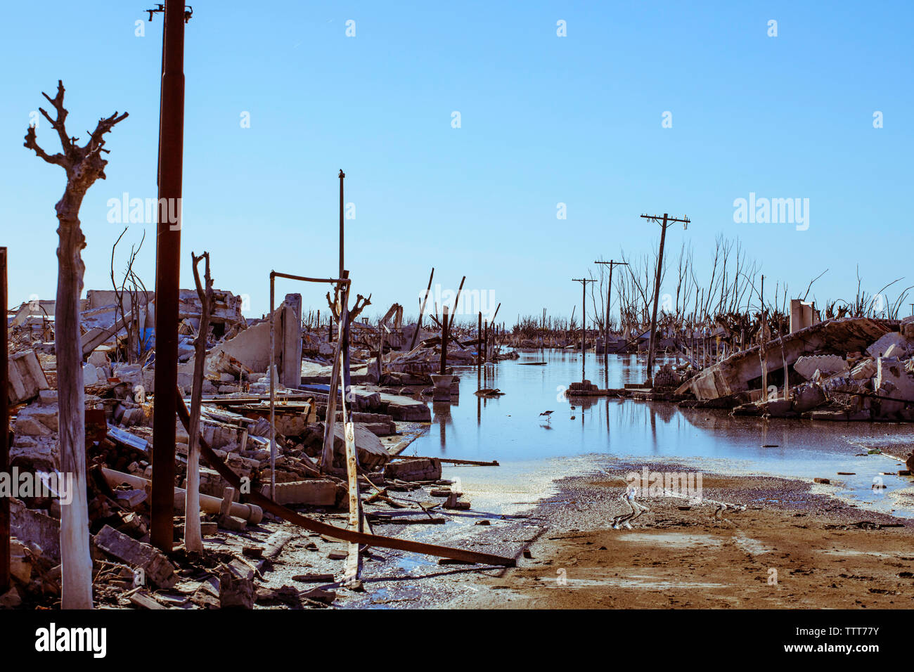 Demolished buildings against clear blue sky during Hurricane Harvey - Stock Image