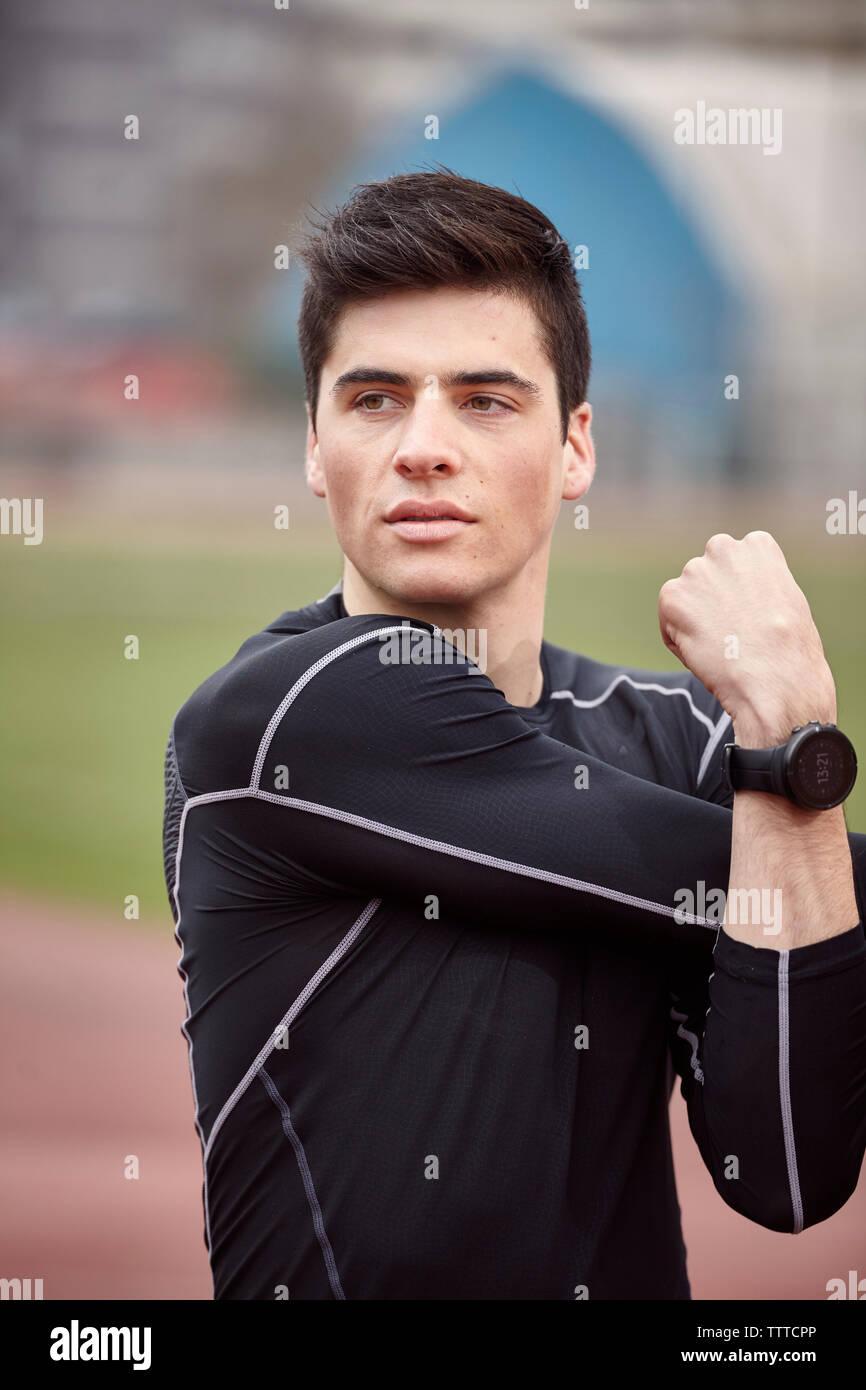 Male athlete exercising on sports track Stock Photo