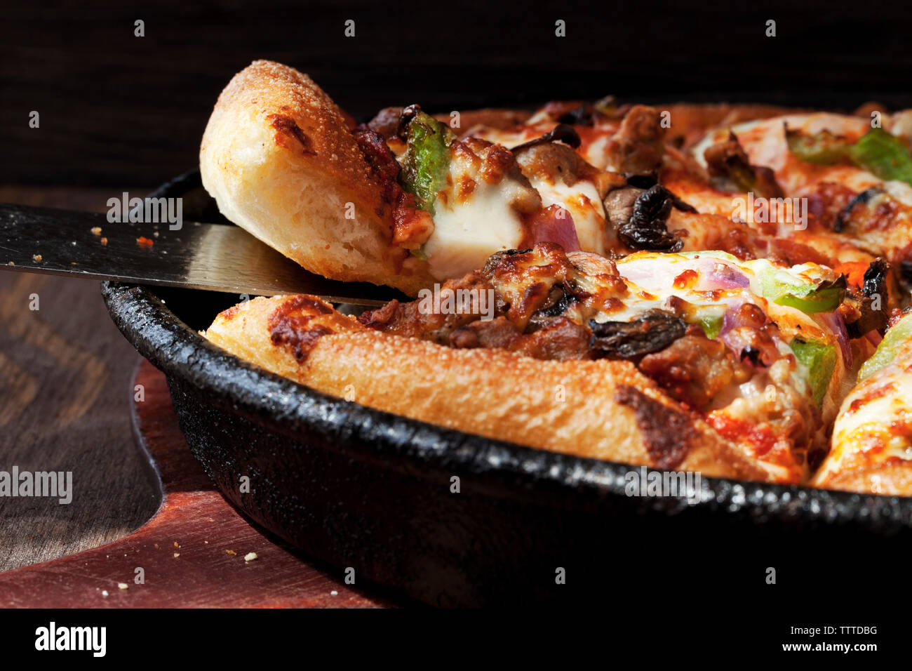 Close-up of spatula in pizza - Stock Image