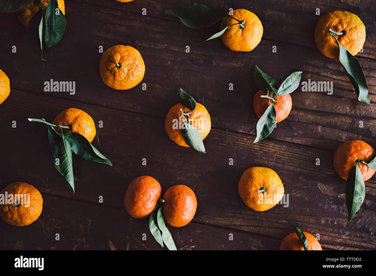 Overhead view of oranges on wooden table Stock Photo