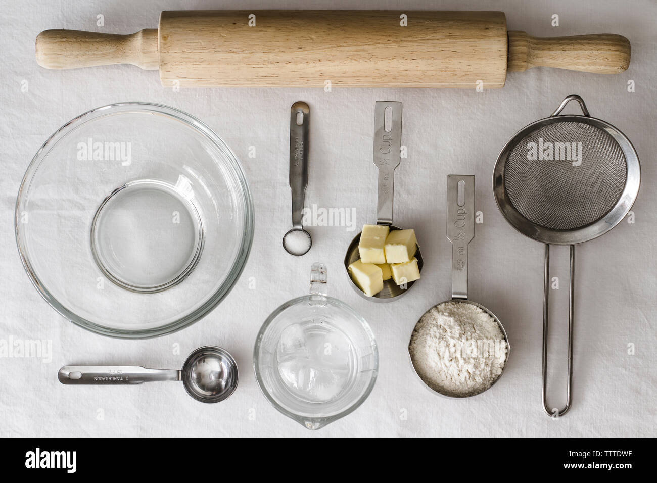 High angle view of ingredients and kitchen utensils on table - Stock Image
