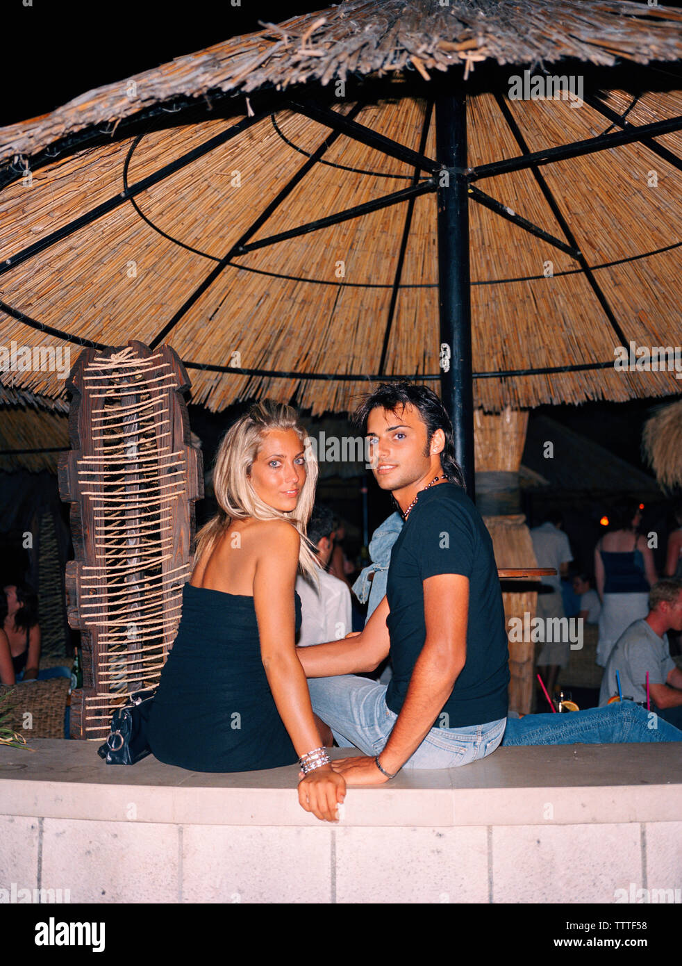 CROATIA, Bol, Brac, Dalmatian Coast, smiling young couple sitting together in Varadero club - Stock Image