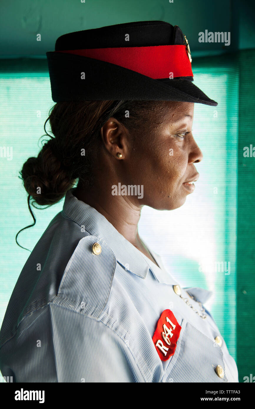 EXUMA, Bahamas. A local police woman at the Staniel Cay Yacht Club at Staniel Cay. - Stock Image