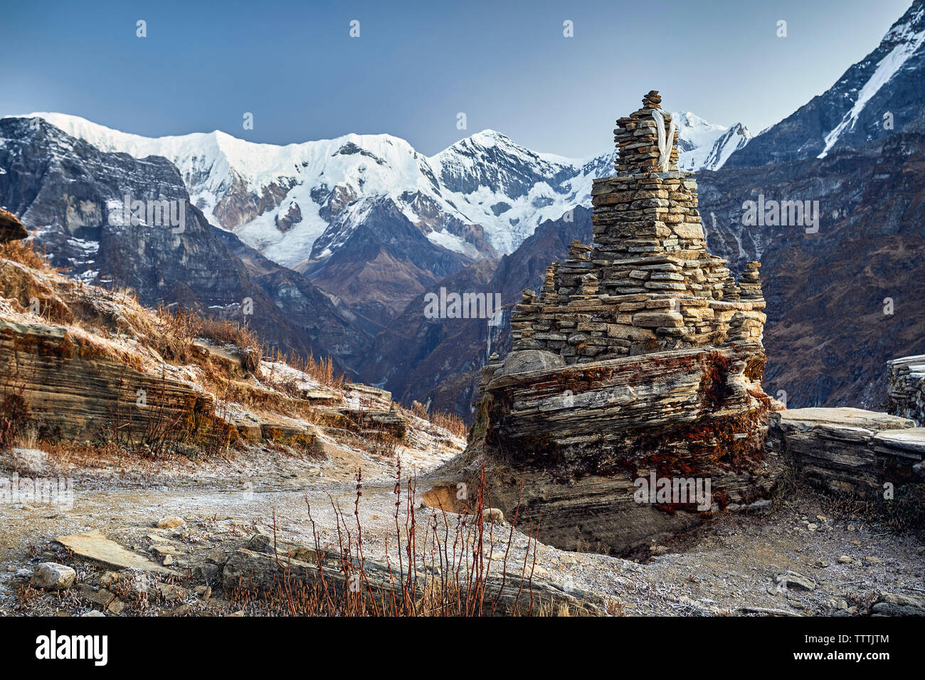 Old ruin stupa on Mardi Himal trek against clear sky during winter - Stock Image