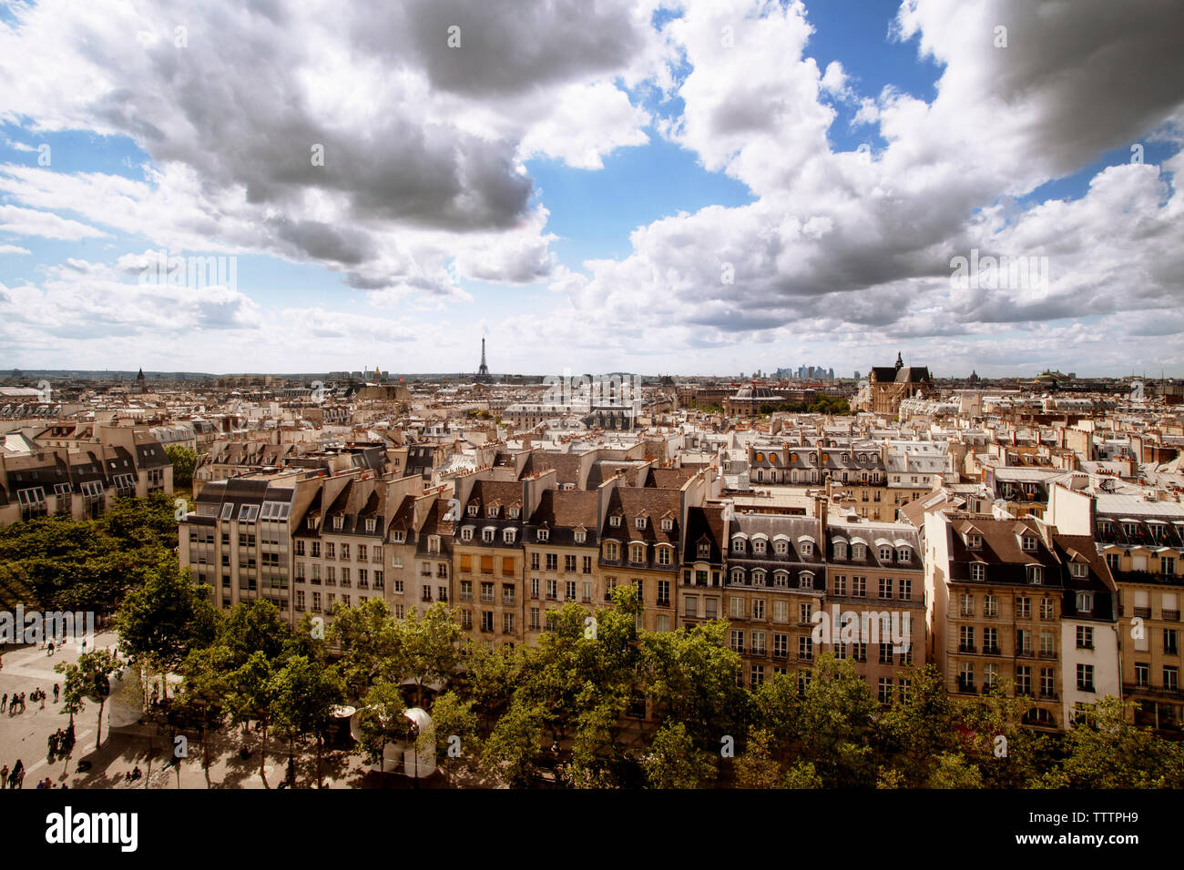 Aerial view of cityscape with Eiffel tower against cloudy sky Stock Photo