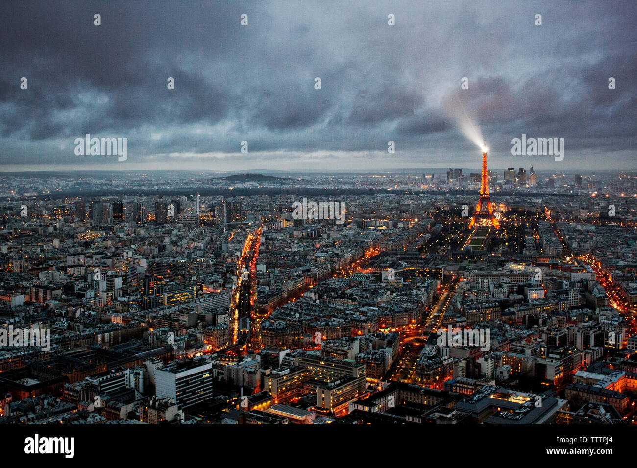 Aerial view of cityscape with illuminated Eiffel tower Stock Photo