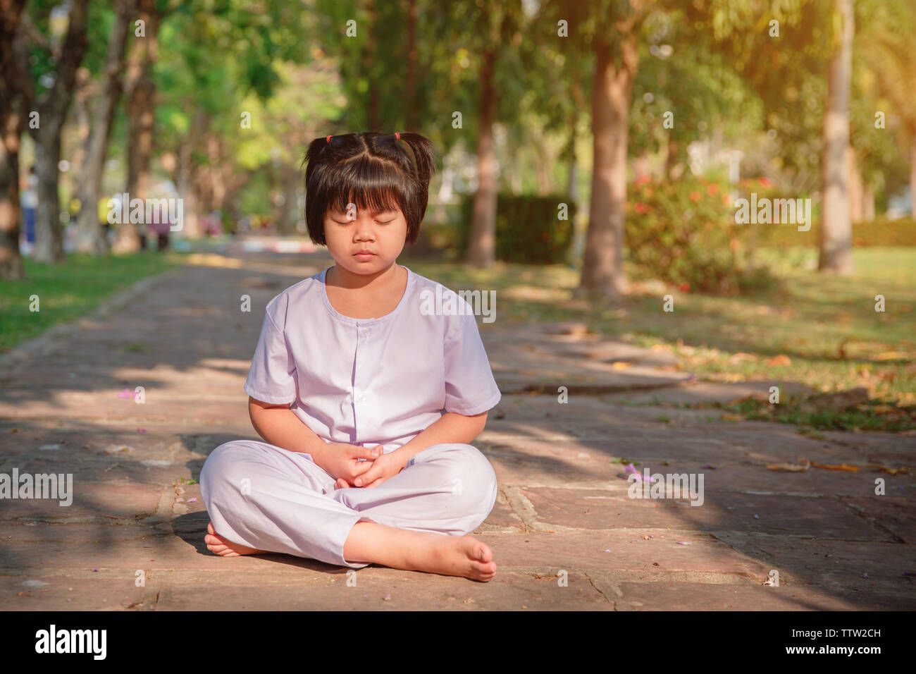 Asian Children Cute Or Kid Girl Sit For Meditation With Peace And Relax In Garden Pavilion At Temple Or Church And Wearing White Dress With Sunlight O Stock Photo Alamy