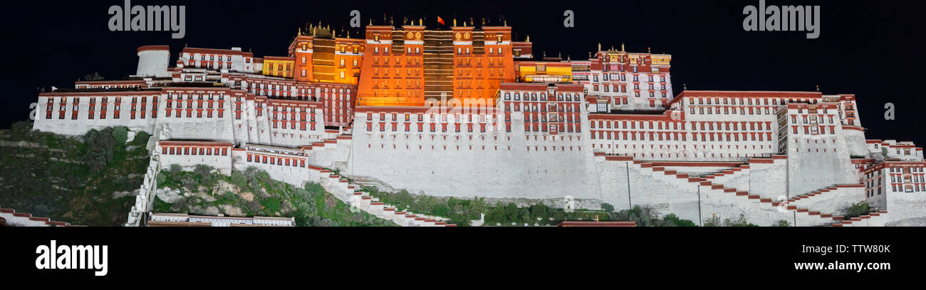 Panorama view of Potala Palace at night (Tibet). The palace was home of the 14th Dalai Lama until he fled to India during the 1959 Chinese invasion. - Stock Image