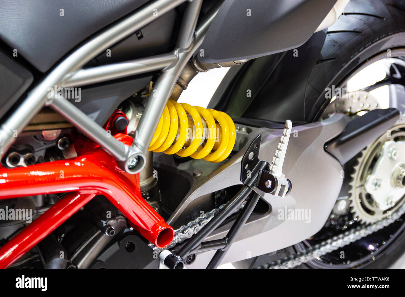 yellow Shock Absorbers of Motorcycle for absorbing jolts net technology concept new technology design - Stock Image