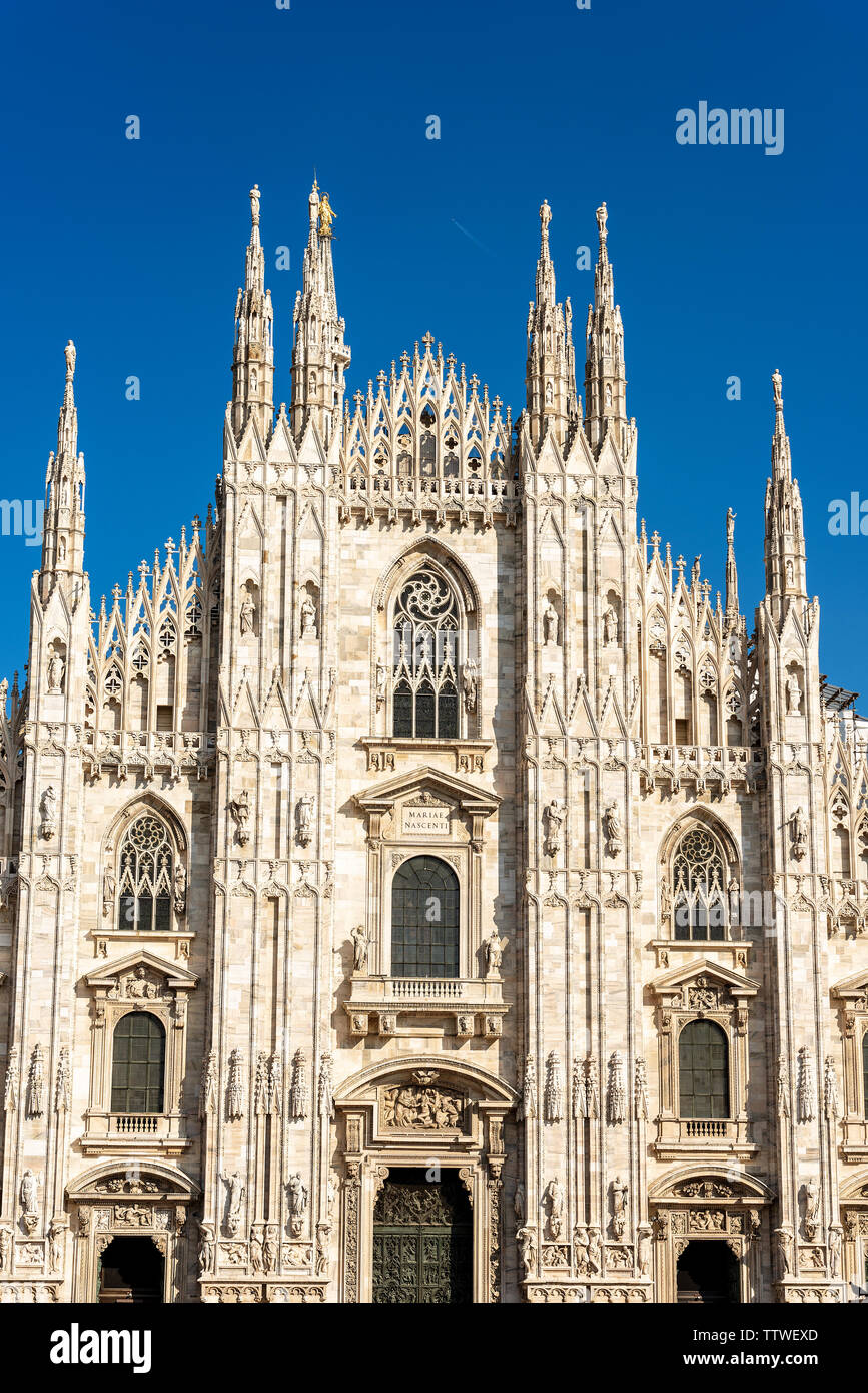 Facade of the Duomo di Milano (Milan Cathedral 1418-1577). Church, monument symbol of Lombardy, Italy, Europe - Stock Image