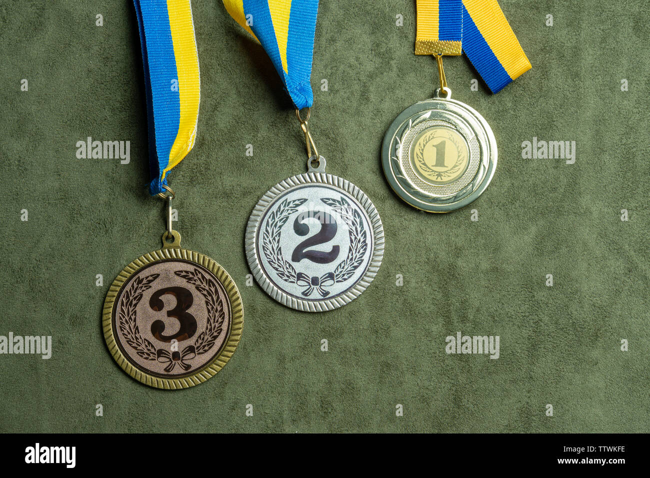 Gold, silver or bronze medal with yellow and blue ribbons - Stock Image