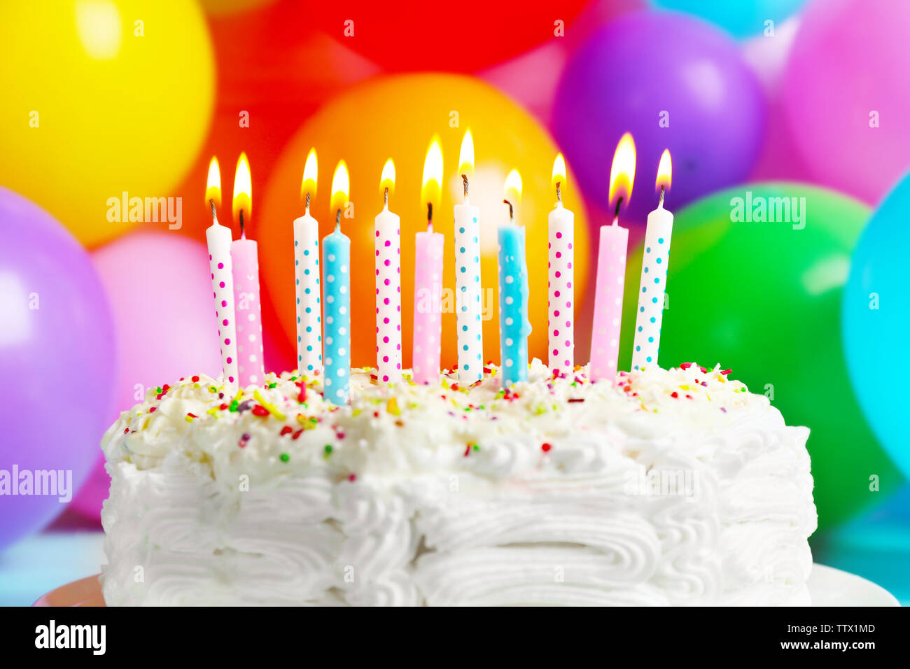 Birthday Cake With Candles.Birthday Cake With Candles On Balloons Background Stock