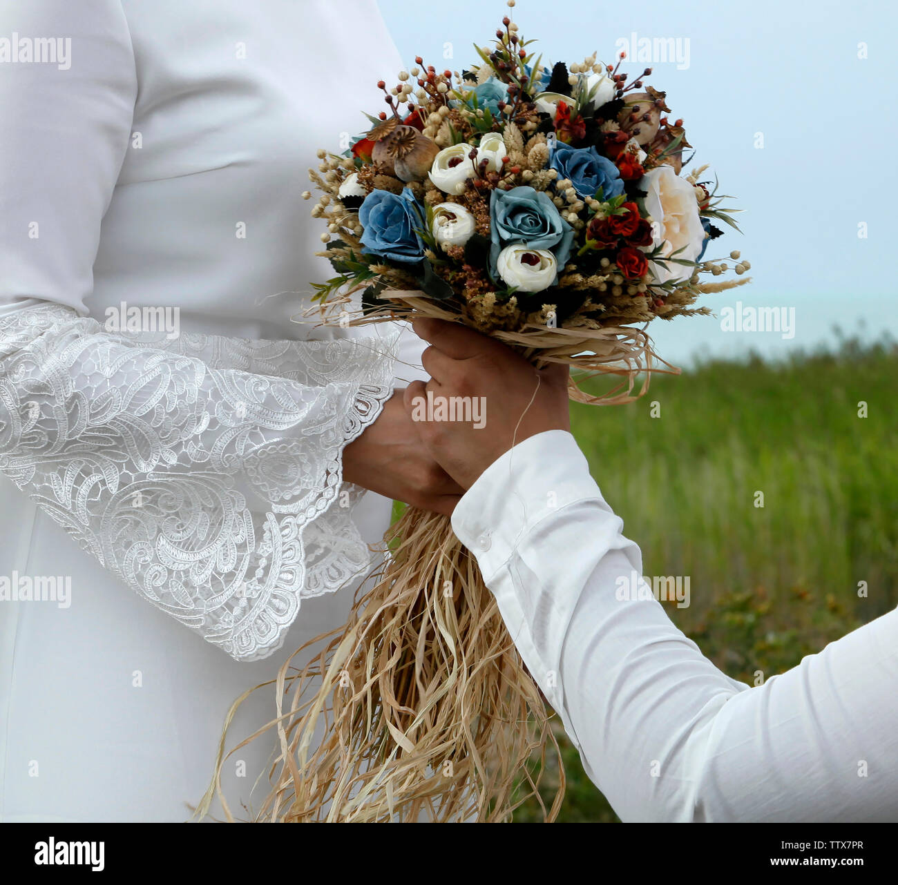 bride and groom in nature - Stock Image