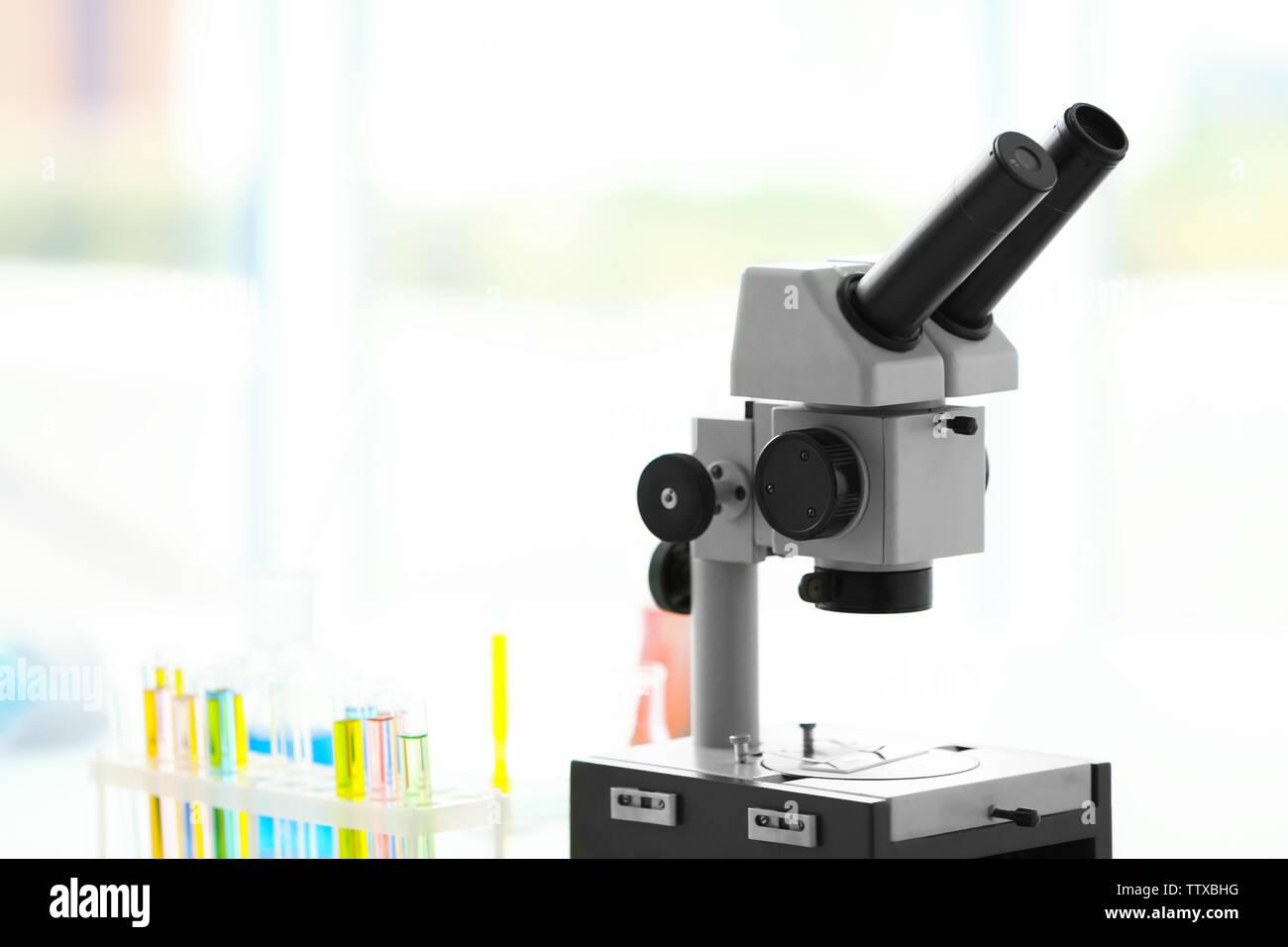 Modern microscope in office - Stock Image