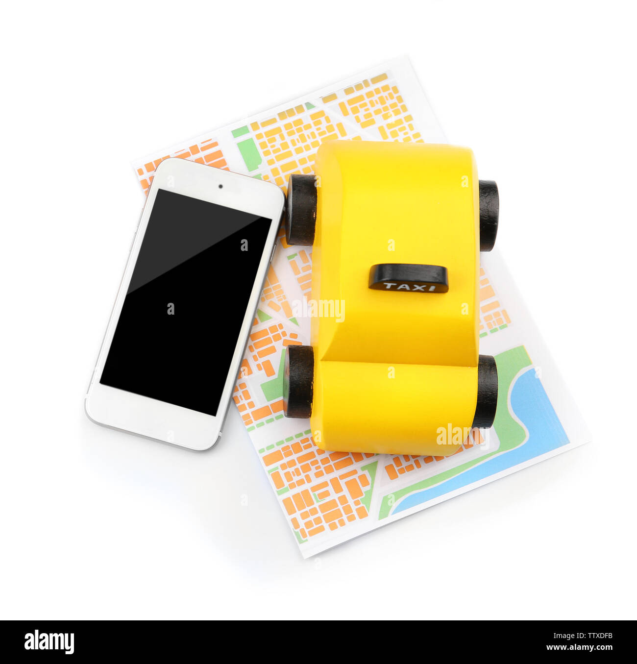 Yellow toy taxi, map and smartphone on white background - Stock Image