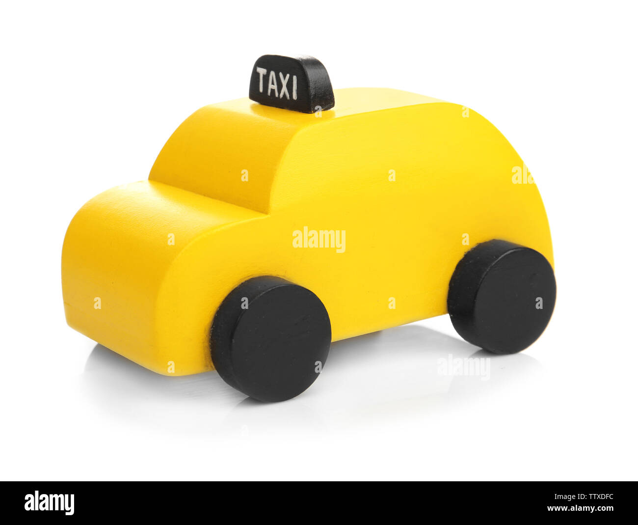 Yellow toy taxi cab isolated on white - Stock Image