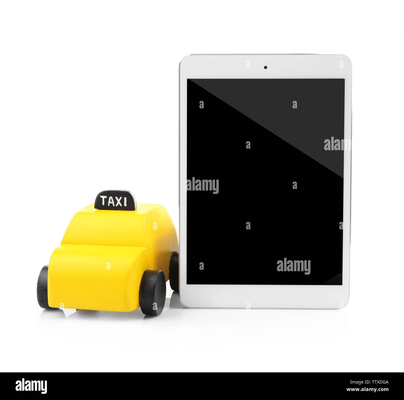 Yellow toy taxi cab and tablet isolated on white - Stock Image