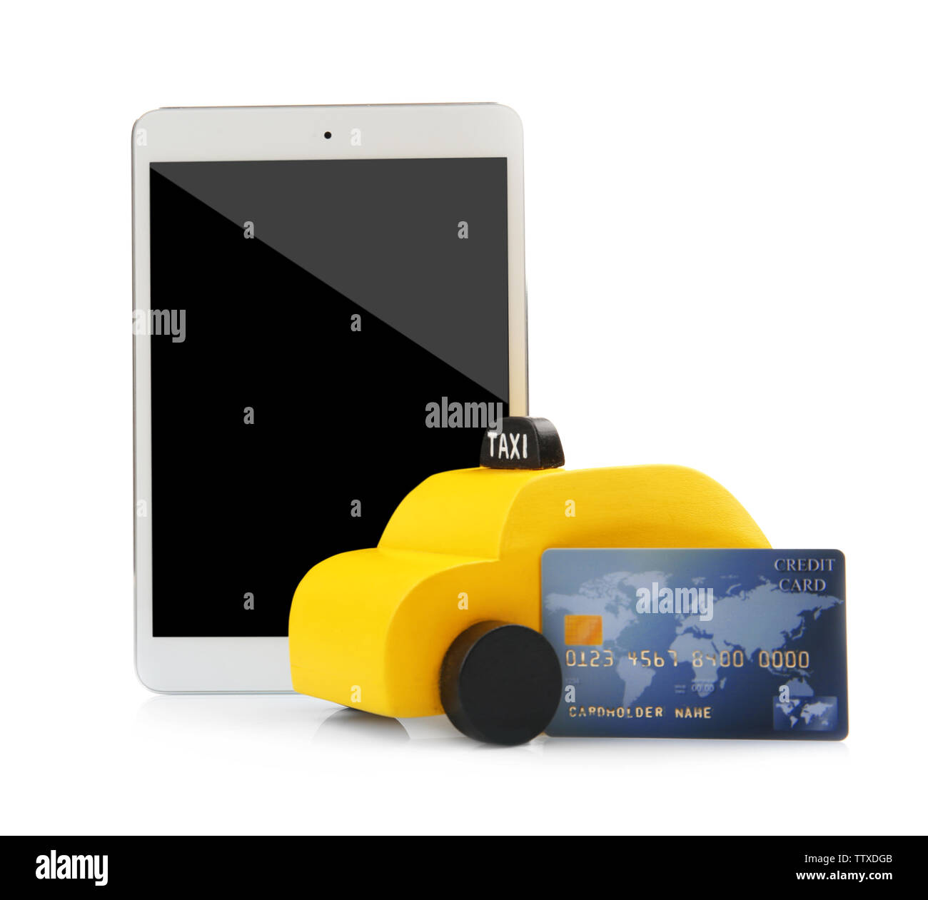 Yellow toy taxi cab, tablet and credit card isolated on white - Stock Image