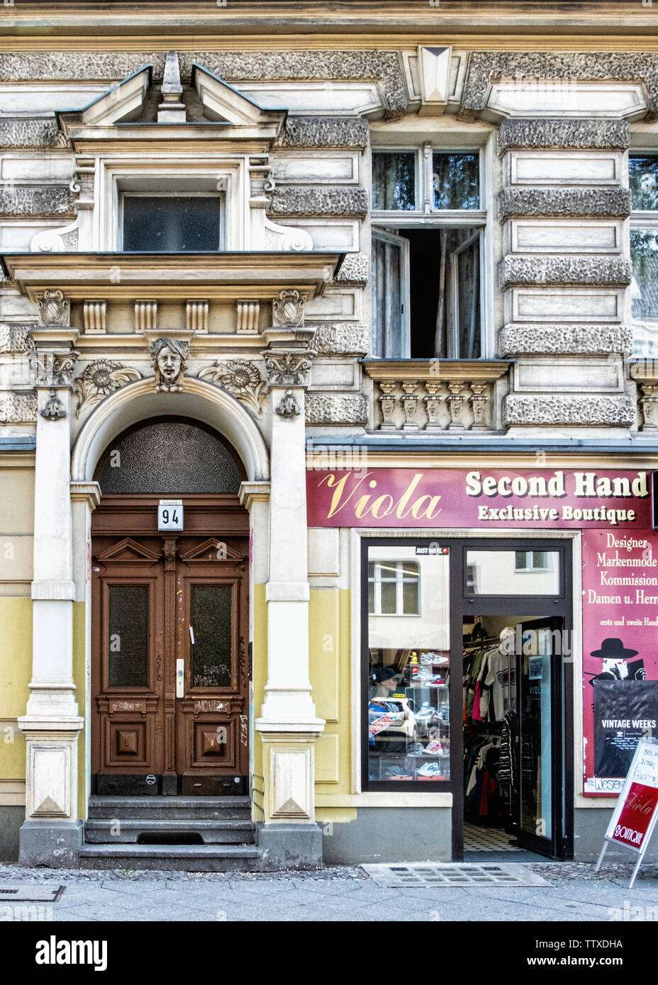 Viola Second hand Boutique sells vintage clothing & fashion for men & women in historic old building in Charlottenburg, Berlin - Stock Image