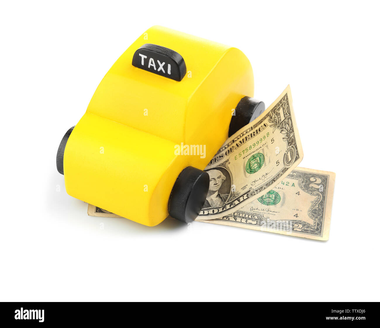 Yellow toy taxi cab and money isolated on white - Stock Image