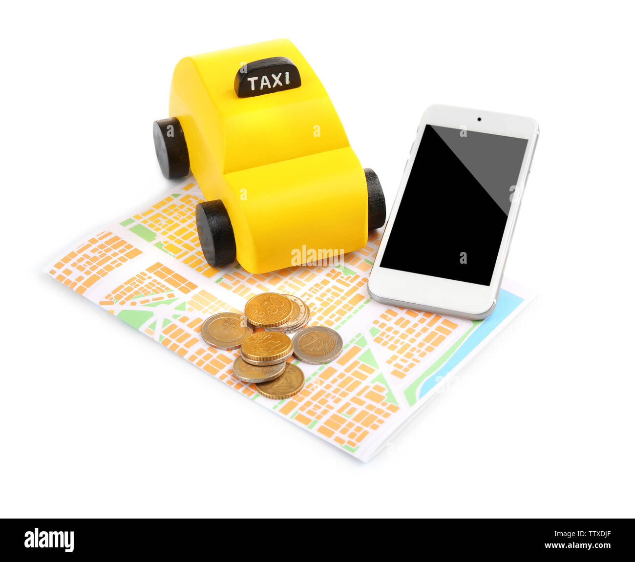 Yellow toy taxi, map, smartphone and coins on white background - Stock Image