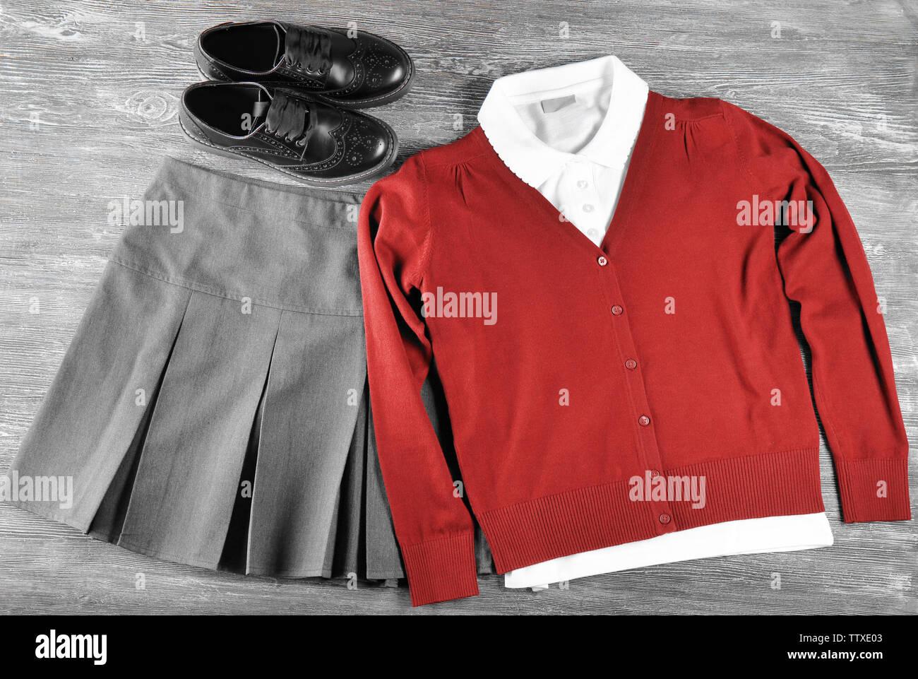 School uniform on wooden background - Stock Image