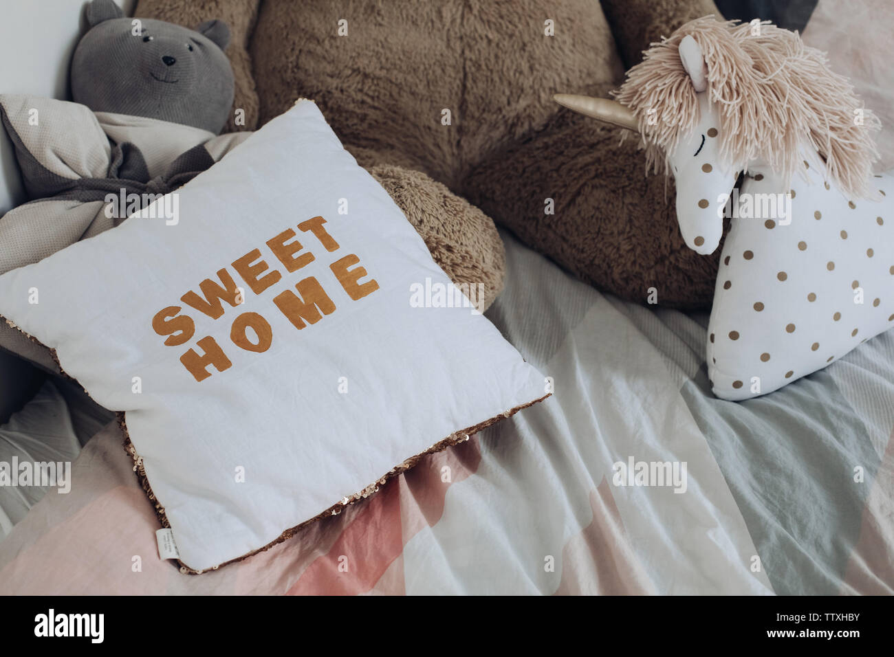 Comfortable pillows and toys of children lying on bed - Stock Image