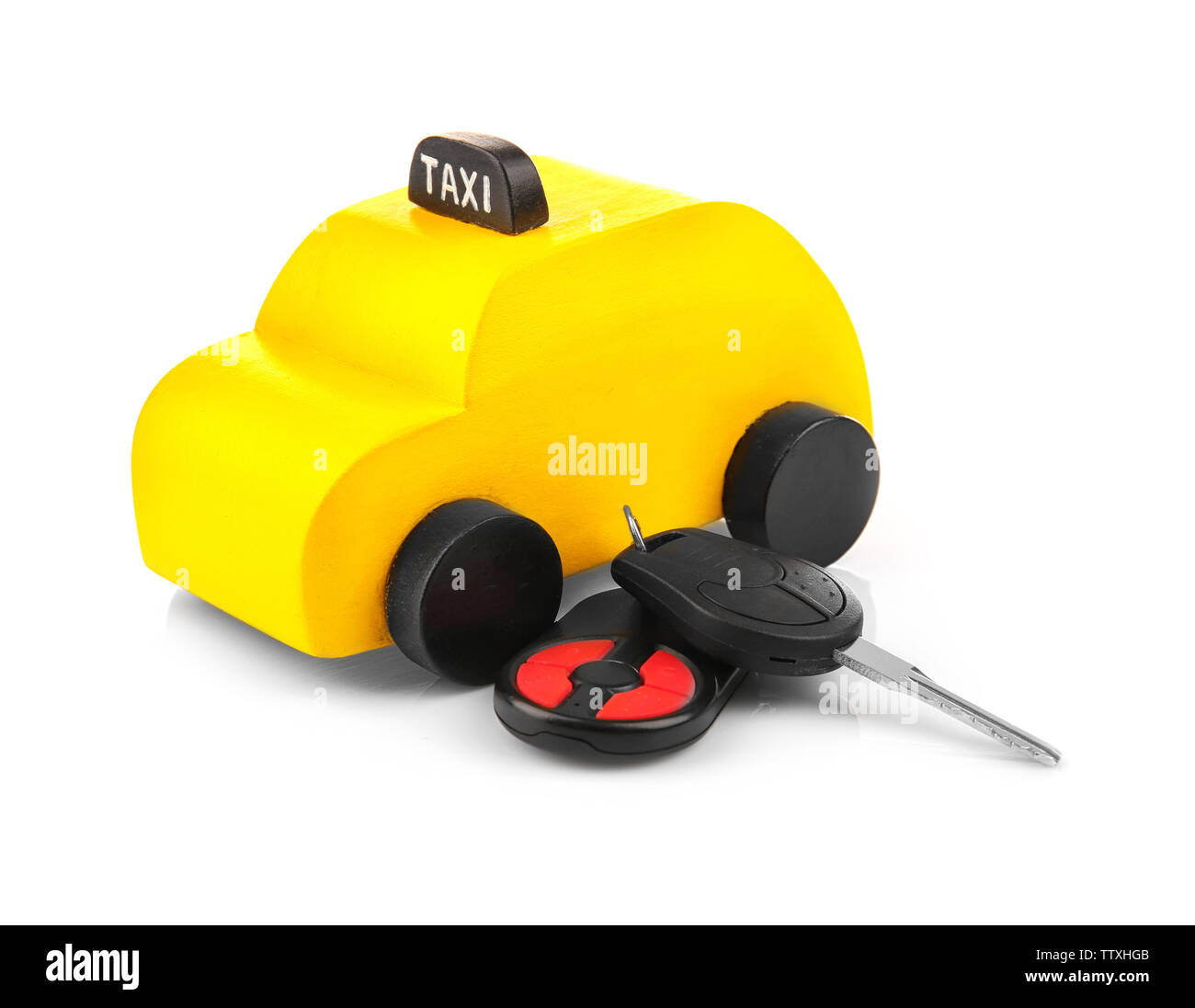 Yellow toy taxi with car key on white background - Stock Image