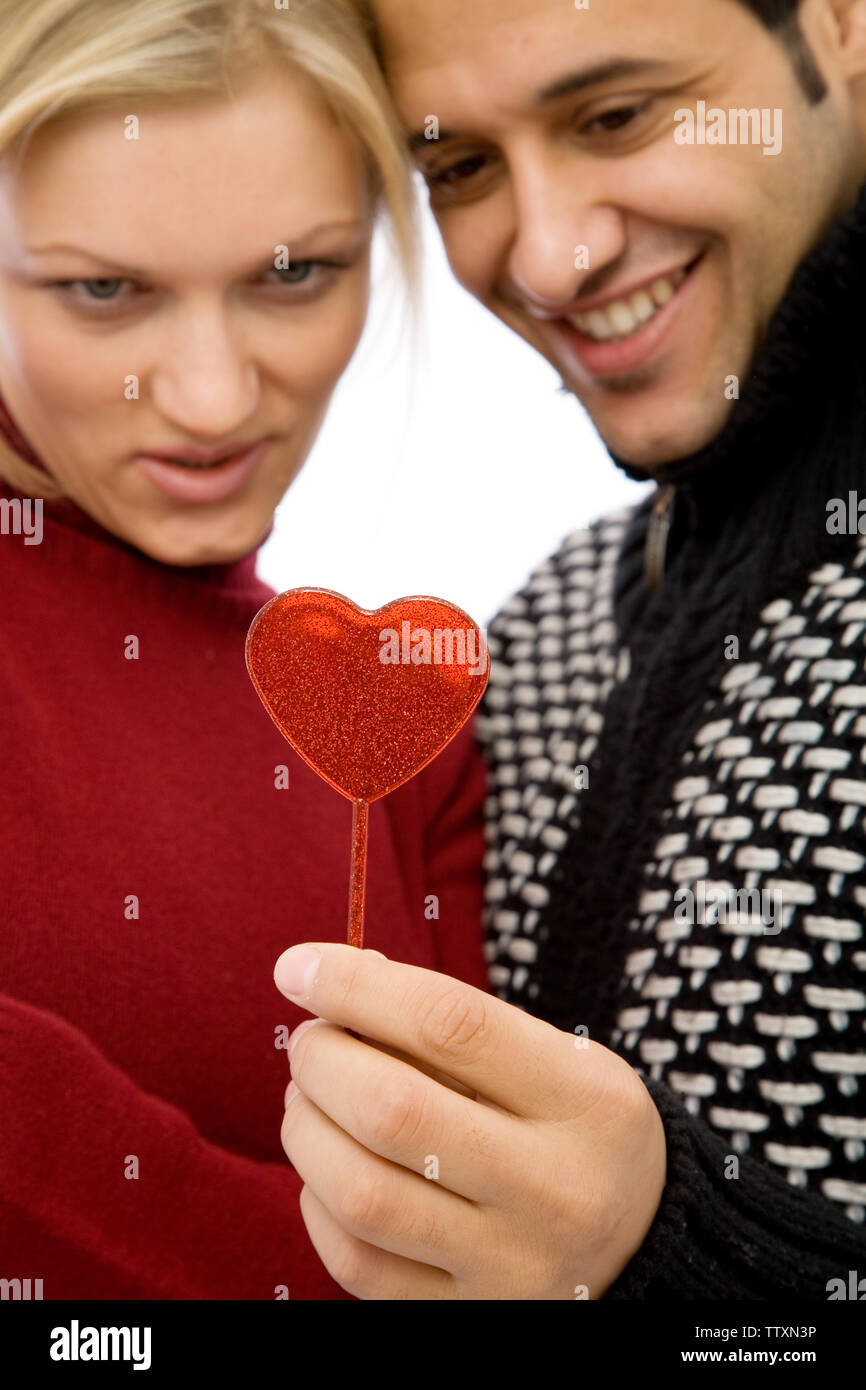 lovely couple with a heart shape for valentine's day, shallow dof - Stock Image