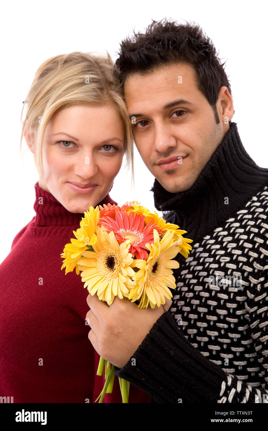 lovely couple with colorful flowers on white background - Stock Image