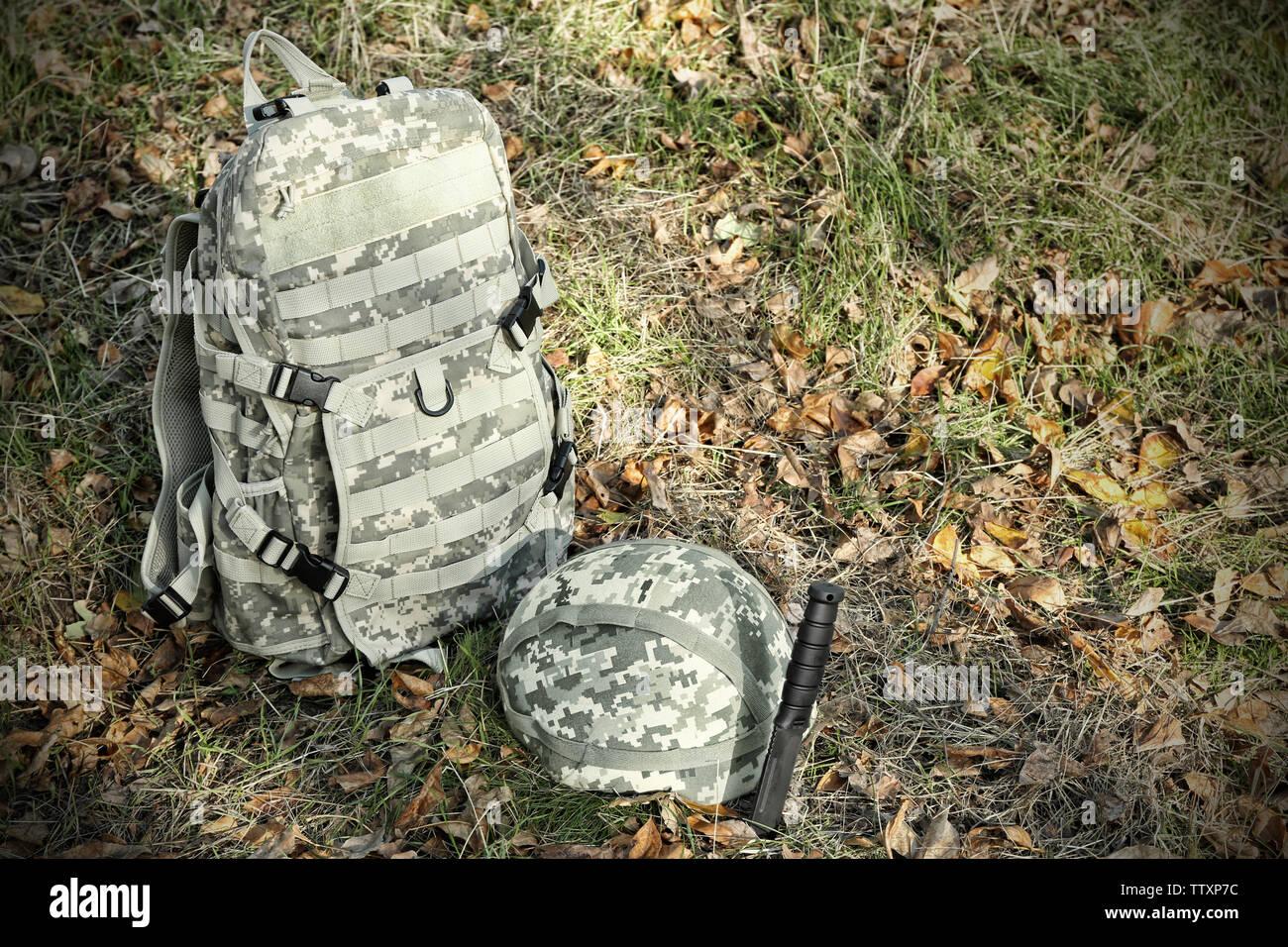 Military set on camouflage background - Stock Image