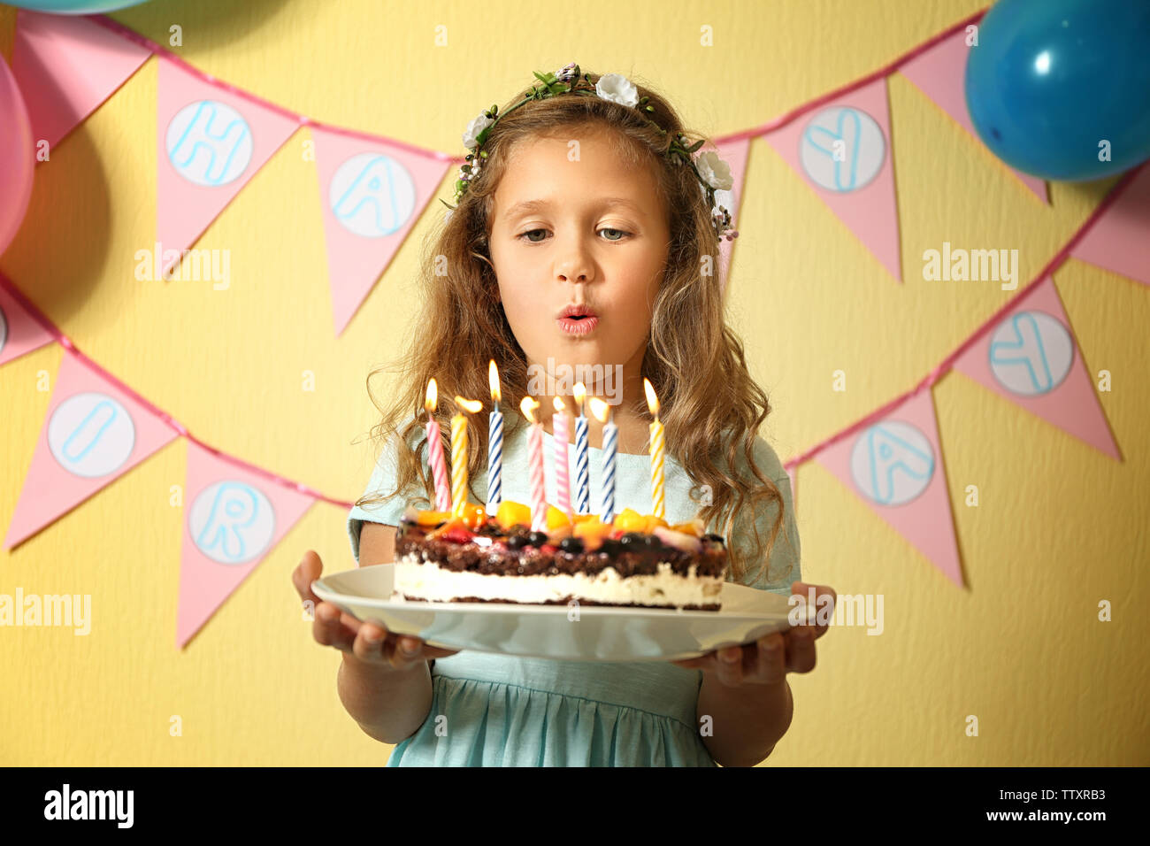 Amazing Cute Little Girl Blowing Out Candles On Birthday Cake At Home Funny Birthday Cards Online Sheoxdamsfinfo