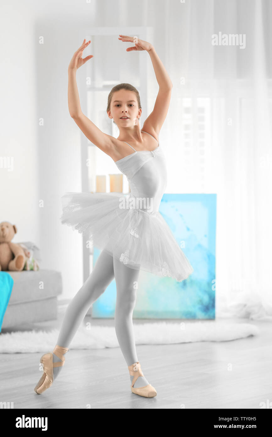 Young Beautiful Ballerina Dancing In Room Stock Photo Alamy