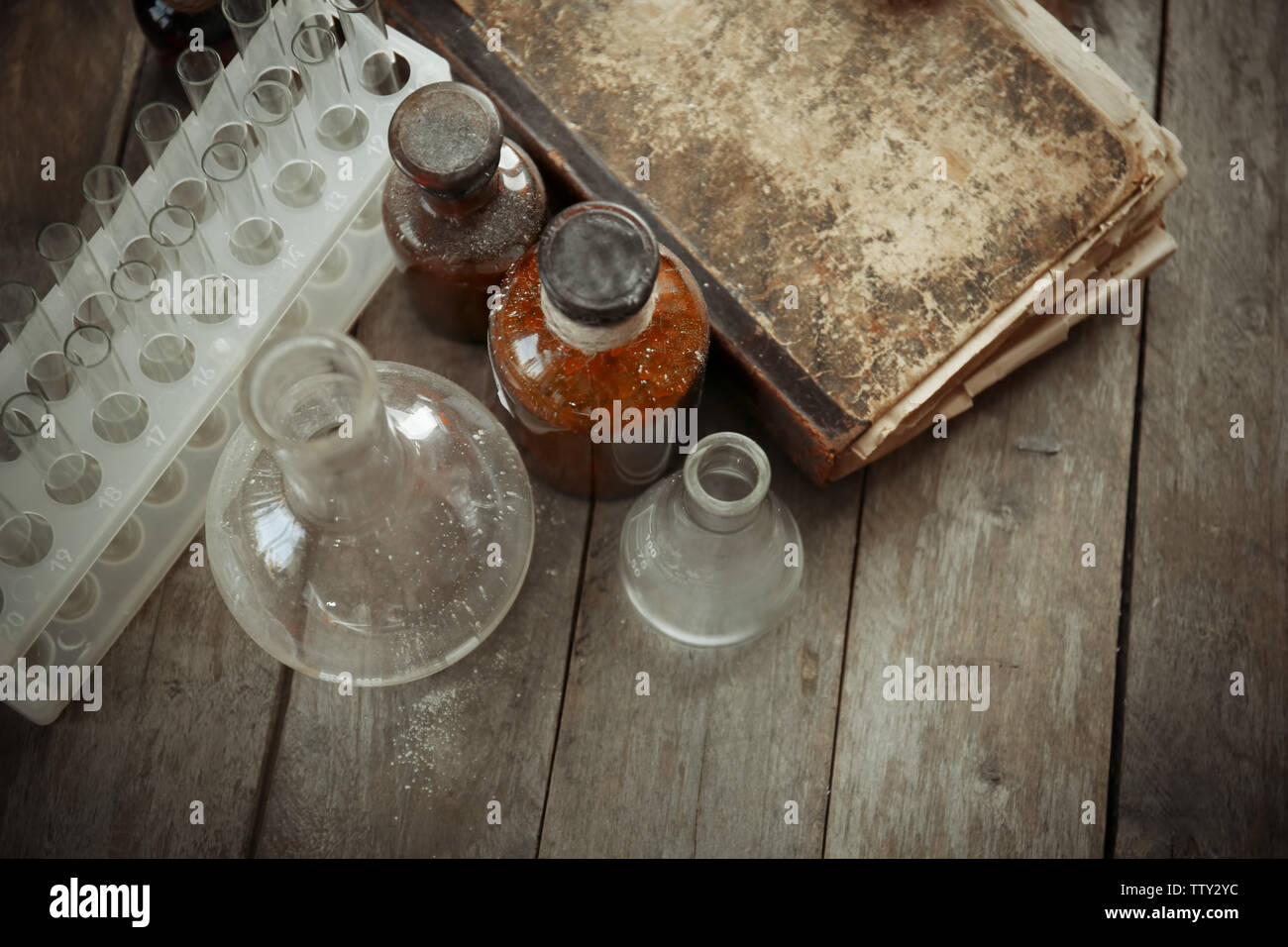 Vintage equipment of chemical laboratory on wooden background, closeup - Stock Image